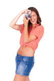 Young women taking pictures with vintage camera Royalty Free Stock Photo