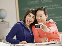 Young women taking self-portrait. With digital camera Stock Images