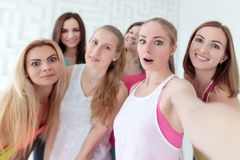Young women taking a selfie at the fitness studio royalty free stock photos