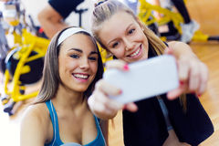 Young women taking a selfie in the gym. Royalty Free Stock Images