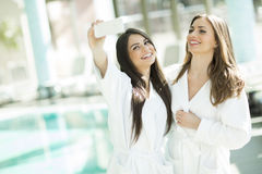 Young women taking selfie with mobile phone in spa center Royalty Free Stock Photos