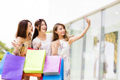 Young Women Taking  Selfie while Shopping Royalty Free Stock Image
