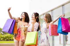 Young Women Taking  Selfie while Shopping Stock Photography