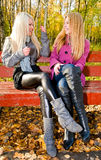 Young women talking on the bench Stock Photos