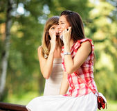 Young women talking on cell phone. Royalty Free Stock Image
