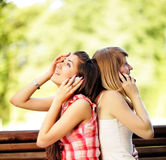 Young women talking on cell phone. Royalty Free Stock Images