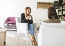 Young women talking and drinking tea Stock Photo