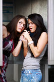 Young women talking on payphone Royalty Free Stock Photos
