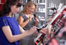 Young women testing and buying Stock Photo