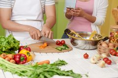 Couple cooking pasta with sauce royalty free stock images