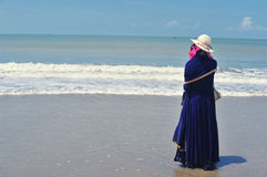 A young women thinking deeply standing alone at sea beach. A young woman thinking deeply looking away Royalty Free Stock Photography