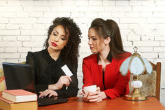 Young women to make purchases using the online service Stock Photos