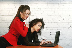Young women to make purchases using the online service Royalty Free Stock Photo