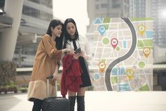 Young woman tourist using gps map in a smart phone in the city. Young women tourist using gps map in a smart phone in the city background stock photo