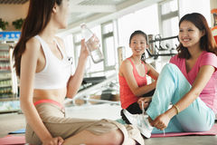 Young women after training in the gym Stock Photos