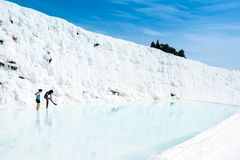 Young women in a travertine pool at Pamukkale, Turkey Royalty Free Stock Photos