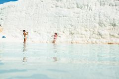 Young women in a travertine pool at Pamukkale, Turkey Stock Images