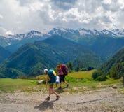 Young women trekking in Svaneti,. Georgia Stock Photo