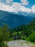 Young women trekking in Svaneti,. Young hikers trekking in Svaneti, Georgia Royalty Free Stock Images