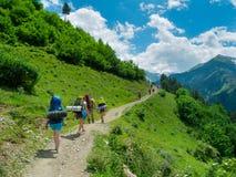 Young women trekking in Svaneti,. Young hikers trekking in Svaneti, Georgia Stock Photos