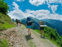 Young women trekking in Svaneti,. Young hikers trekking in Svaneti, Georgia Royalty Free Stock Image