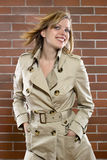Young women in a trenchcoat. Beautiful young women is posing in a trenchcoat Stock Photo