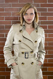 Young women in a trenchcoat. Beautiful young women is posing in a trenchcoat Royalty Free Stock Photos