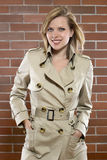 Young women in a trenchcoat. Beautiful young women is posing in a trenchcoat Royalty Free Stock Images