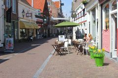 Young women enjoy at a trendy terrace,Amersfoort,Netherlands  Royalty Free Stock Photos