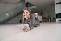 Young women used tablet computer on the floor Stock Images