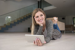 Young women used tablet computer on the floor Royalty Free Stock Images