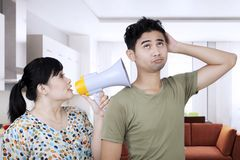 Young woman shouting to his husband at home Stock Image