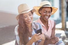 Young women using mobile phone. Young women having fun while text messaging on mobile phone Stock Images