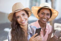 Young women using mobile phone. Portrait of young women using mobile phone Royalty Free Stock Photography