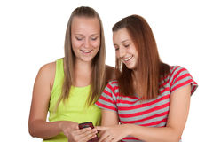 Young women using mobile phone together Royalty Free Stock Images