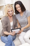 Young Women Using Tablet Computer At Home Stock Images