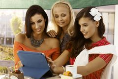 Young women using tablet Royalty Free Stock Photography
