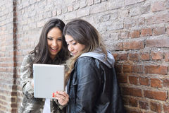 Young women using a tablet. Stock Photography
