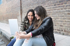 Young women using a tablet. Stock Images