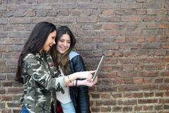 Young women using a tablet. Stock Image