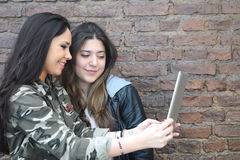 Young women using a tablet. Royalty Free Stock Images