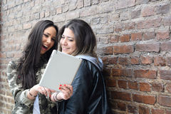 Young women using a tablet. Royalty Free Stock Photos