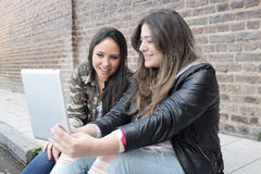 Young women using a tablet. Royalty Free Stock Image