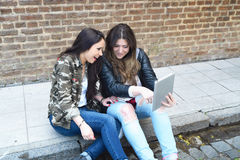 Young women using a tablet. Royalty Free Stock Photography