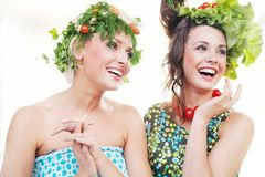 Young women with vegetables hairstyles Stock Photography