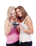 Young women viewing pictures Stock Images