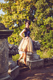 Young women in vintage dress in park Roseburg Stock Images
