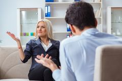 The young woman visiting psychiatrist man doctor for consultation. Young women visiting psychiatrist men doctor for consultation Royalty Free Stock Photo