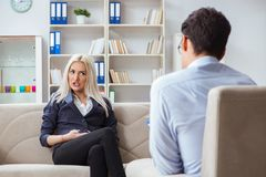 The young woman visiting psychiatrist man doctor for consultation. Young women visiting psychiatrist men doctor for consultation Stock Image