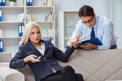 The young woman visiting psychiatrist man doctor for consultation. Young women visiting psychiatrist men doctor for consultation Royalty Free Stock Photography